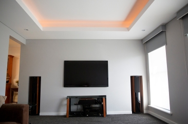 Recessed Light Trough with recessed television and speakers