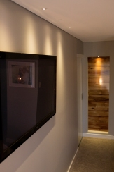 Bring a modern touch into a 1970's home with P50 negative detail, feature timber wall niche and recessed television