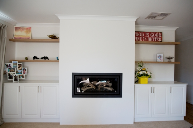 Recessed gas heater fireplace with built in cabinets